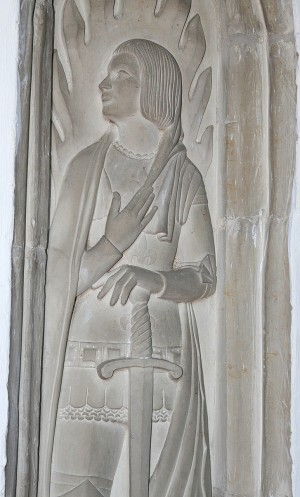 Statue of Joan of Arc found on the north aisle pillar. This memorial commemorates Jean Cheverton, a young parishioner who died in 1954.