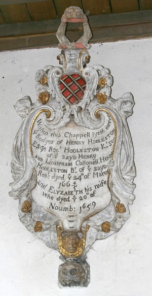 Memorial commemorating the Huddlestons who lived at Sawston Hall for 500 years. Their remains lie beneath the church floor.