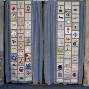 The curtains at the entrance to the priest's vestry. These were designed and made by the congregation in 1995 – men and women aged 4-86 years contributed to the project.