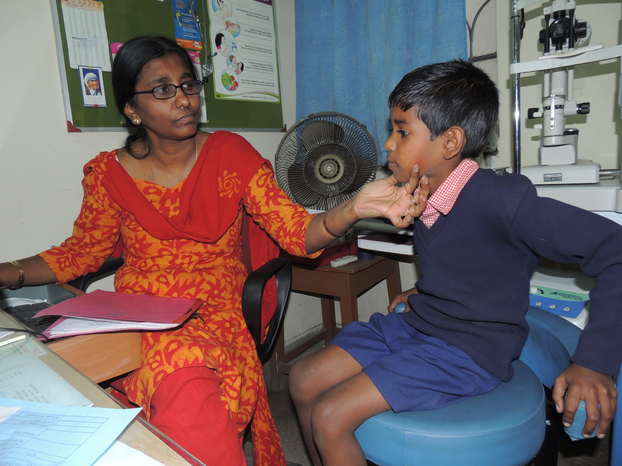 Dr Helen Roberts examines eight-year-old Akash Singh at Premananda Hospital.